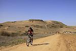 Israel, Coastal Plain, cycling by Nahal Shikma, Tel Nagila is in the background