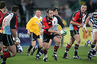 Harlequins centre Keith Pyper moves play wide during the First Trust Senior Cup Final at Ravenhill. Result - Dungannon 27pts Harlequins 10pts.