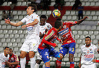 MANIZALES -COLOMBIA, 18-09-2013. Sergio Herrera (I) de Once Caldas disputa el balón con Juan Villota (C) y Yerry Mina (D) de Deportivo Pasto  válido por la fecha 11 de la Liga Postobón II 2013 jugado en el estadio Palogrande de la ciudad de Manizales./ Once Caldas player Sergio Herrera (L) fights for the ball with Deportivo Pasto players Juan Villota (C) and Yerry Mina (R) during match valid for the 11th date of the Postobon League II 2013 at Palogrande stadium in Manizales city. Photo: VizzorImage/Yonboni/STR
