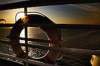 Life buoy on railing of cruiseship on Nile River at sunset, Egypt