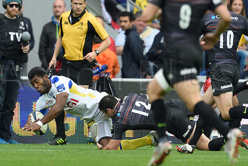 18.04.2015. Clermont-Ferrand, Auvergne, France. Champions Cup rugby semi-final between ASM Clermont and Saracens.   Noa Nakaitaci (asm) brought down by Brad Barritt (saracens)