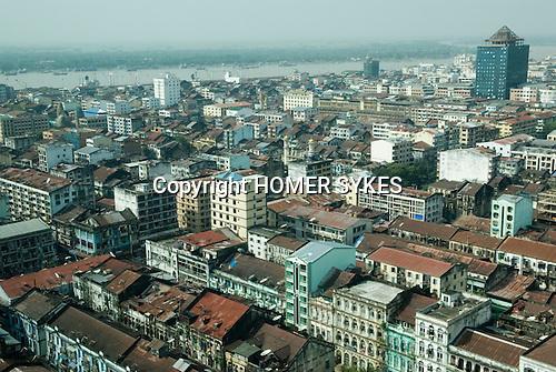View of down town Yangon, with shipping on the busy Ayeyarwady river. Myanmar ( Rangoon Burma ) South East Asia 2006.