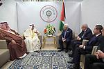 Palestinian President Mahmoud Abbas meets with Deputy Prime Minister of Bahrain, Sheikh Mohammed bin Mubarak Al Khalifa during the 30th Arab League summit in the Tunisian capital Tunis on March 31, 2019. Photo by Thaer Ganaim