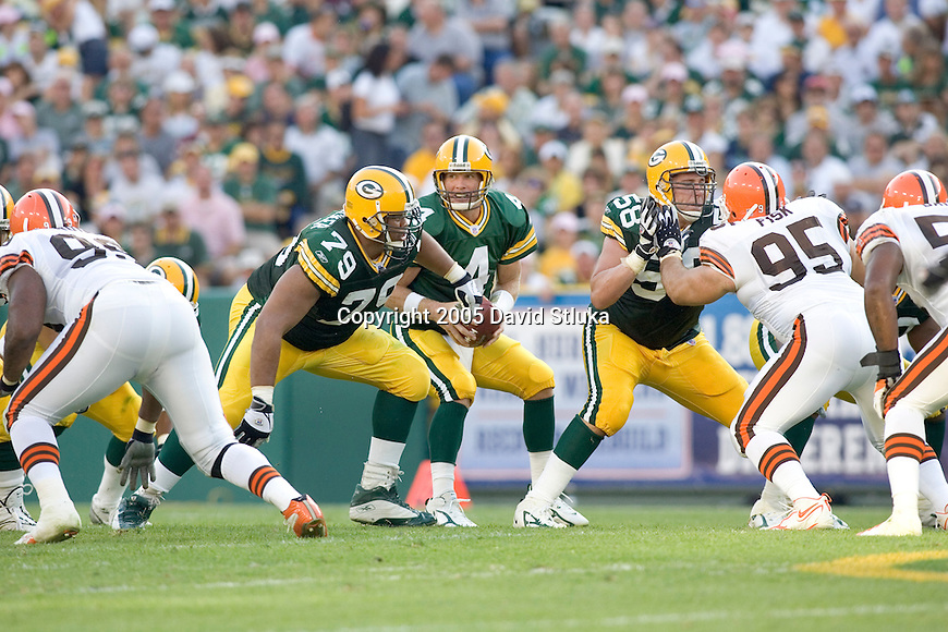 GREEN BAY, WI - SEPTEMBER 18: Offensive linemen William Whitticker #79 and Mike Flanagan #58 of the Green Bay Packers defend quarterback Brett Favre #4 against the Cleveland Browns at Lambeau Field on September 18, 2005 in Green Bay, Wisconsin. The Browns defeated the Packers 26-24. (Photo by David Stluka)