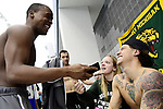GREENSBORO, NC - MARCH 15: Drury State swimmers laugh in conversation in the bleachers during the Division II Men's and Women's Swimming & Diving Championship held at the Greensboro Aquatic Center on March 15, 2018 in Greensboro, North Carolina. (Photo by Mike Comer/NCAA Photos/NCAA Photos via Getty Images)