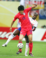 William Gallas (5) of France tries to poke the ball from Jae Jin Cho (19) of Korea. The Korea Republic and France played to a 1-1 tie in their FIFA World Cup Group G match at the Zentralstadion, Leipzig, Germany, June 18, 2006.
