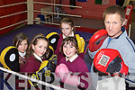 PUNCH UP: Pupils from St Joseph's School in Ballybunion getting some tuition from Graham Ball of the Cashen Vale Boxing Club, l-r: Hannah Walsh, Louise Hanrahan, Emma Kennelly and Rene?e Cooke.