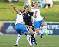 Sonia Bompastor #8 of the Washington Freedom gets caught between Alex Scott#22 and Heather Mitts #2 of the Boston Breakers during a WPS match at the Maryland Soccerplex, in Boyd's, Maryland, on April 18 2009.