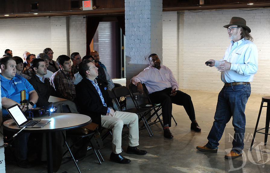 NWA Democrat-Gazette/ANDY SHUPE<br /> Mark Zweig, a local entrepreneur, speaks Wednesday, Feb. 17, 2016, to a large group gathered during a workshop for entrepreneurs organized by Hayseed Ventures at the Old Post Office building on the Fayetteville square.