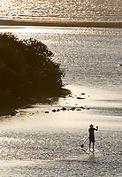 A paddleboarder heads down Yardie Creek toward the Indian Ocean.