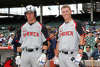 Stryker Trahan #22 and Cason Kelly #13 during the Under Armour All-American Game at Wrigley Field on August 13, 2011 in Chicago, Illinois.  (Mike Janes/Four Seam Images)