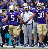 Jimmy Lake lauds Myles Bryant. Bryant put on a show, with a sack and two interceptions on the day.