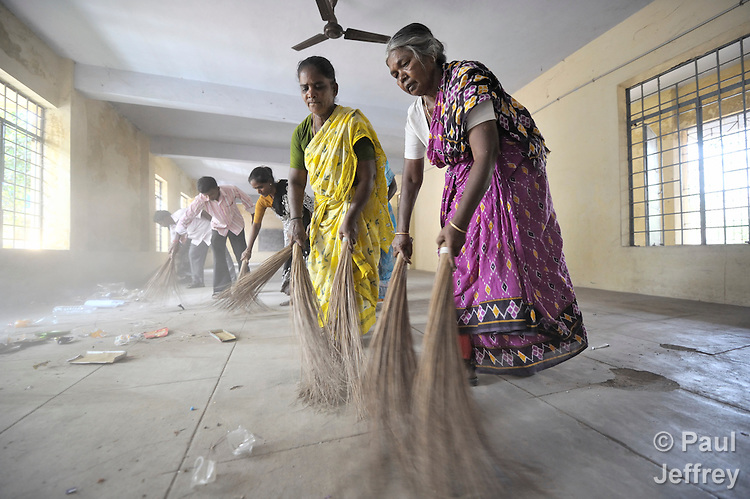 Volunteers clean up a community center in the Chetpet neighborhood in Chennai, a city in the southern India state of Tamil Nadu.