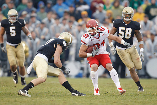 Utah tight end Kendrick Moeai (#81) prepares for hit by Notre Dame safety Zeke Motta (#17) during NCAA football game between Utah and Notre Dame.  The Notre Dame Fighting Irish defeated the Utah Utes 28-3 in game at Notre Dame Stadium in South Bend, Indiana.