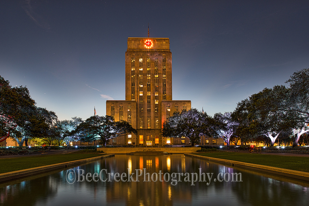 This is a image of the Houston City Hall at night it is part of the cityscape.  There was a little light in the sky but it was close to dark when we took this and luckly there was no wind so the building was reflected back into the water which was nice feature. The first couple of city halls burned down but this on was commission to be build in 1933 and was finally built in July of 1939.  Also the new City Hall  building was one of the first office buildings with air conditioning.