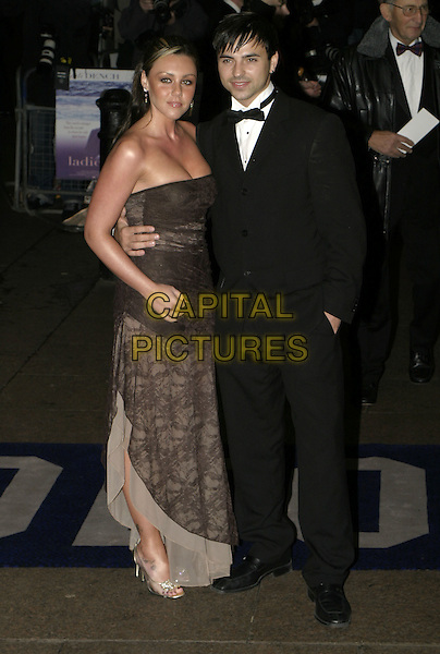 "MICHELLE HEATON & ANDY SCOTT-LEE.""Ladies in Lavender"" Royal Film Performance and premiere, Odeon Leicester Square, London, .November 8th 2004..full length brown lace strapless dress couple.Ref: AH.www.capitalpictures.com.sales@capitalpictures.com.©Capital Pictures."