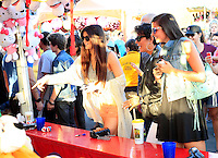 Keeping up with the Kardashians: Kris Jenner treated her daughter Kylie and a bunch of friends with a trip to the Orange County Fair in Costa Mesa on a sunny Saturday afternoon. The Jenners were accompanied by Cody_Simpson's sister Alli_Simpson and a whole entourage of bodyguards and production people, who made sure that the outing was caught on film. ..Before the gang headed to the concert of Cody_Simpson on the Fair grounds, Kris grabbed a deep fried sweet treat and some ice cream and throw darts with_Kylie to win a stuffed animal. ..Kylie_and her friend later skipped the line at a thrill ride, which caused a couple of BOOs among the waiting crowd. The duo held hands and screamed from the top of their lungs during the ride but they clearly had a lot of fun! Costa Mesa, California on 21.7.2012..Credit: Kilian/face to face / Mediapunchinc - ***NO PRINT FOR WEEKLY MAGAZINES ONLINE ONLY**** */*NortePhoto*<br /> **CREDITO*OBLIGATORIO** <br /> **No*Venta*A*Terceros**<br /> **No*Sale*So*third**<br /> *** No*Se*Permite Hacer Archivo**<br /> **No*Sale*So*third**