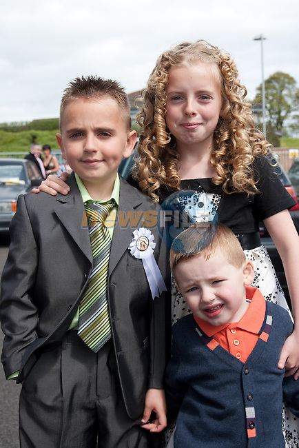 Ciaran O'Connor at St. Patrick's BNS First Communion at the Lourdes Church on Saturday, with brother and sister Megan and Bernard. Picture: Newsfile/Mark Carroll.