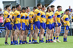 The Clare team stand for the anthem before their Munster championship quarter-final game against Limerick in Cusack park. Photograph by John Kelly.
