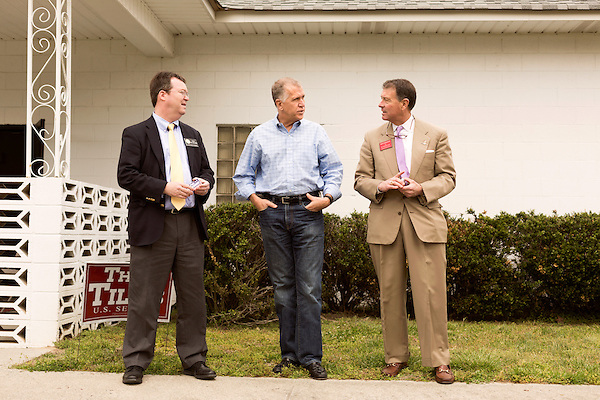 April 6, 2014. Durham, North Carolina.<br />  Thom Tillis, center, is one of eight Republican candidates running for Democrat Kay Hagan's Senate seat. <br /> As the the primary scheduled for May 6th grows near, several of the the eight Republican candidates running for the US Senate seat of incumbent Democrat Kay Hagan have increased their public visibility, appearing at events such as the Durham County Lincoln Douglas Lunch, where each candidate was given a few minutes to address the gathered Republican friendly crowd.