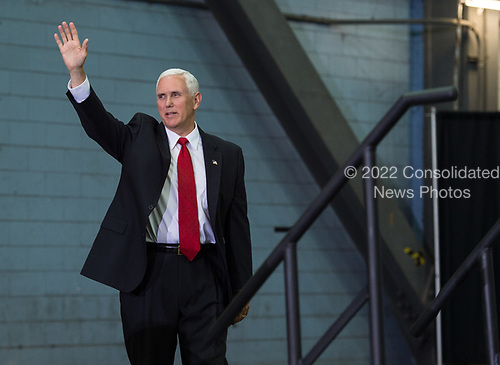 In this photo released by the National Aeronautics and Space Administration (NASA) United States Vice President Mike Pence waves before addressing NASA employees, Thursday, July 6, 2017, at the Vehicle Assembly Building at NASA&rsquo;s Kennedy Space Center (KSC) in Cape Canaveral, Florida. The Vice President thanked employees for advancing American leadership in space, before going on a tour of the center that highlighted the public-private partnerships at KSC, as both NASA and commercial companies prepare to launch American astronauts from the multi-user spaceport. <br /> Mandatory Credit: Aubrey Gemignani / NASA via CNP