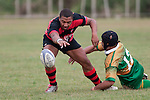 Preston Elama drops the ball as Tukimomo Taulangaarrives to make the tackle.  Counties Manukau Premier Club Rugby Game of the Week between Drury & Papakura, played at Drury Domain on Saturday Aprill 11th, 2009..Drury won 35 - 3 after leading 15 - 5 at halftime.