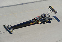 Sept. 29, 2012; Madison, IL, USA: NHRA top fuel dragster driver Troy Buff being towed back to the pits during qualifying for the Midwest Nationals at Gateway Motorsports Park. Mandatory Credit: Mark J. Rebilas-