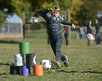 NWA Democrat-Gazette/ANDY SHUPE<br /> Ayden Ballinger, 7, of Greenland kicks a soccer ball Saturday, Oct. 27, 2018, at a pyramid of soup cans while wearing a Halloween costume during a fall festival at Apple Seeds annual Pick or Treating at the organization's teaching farm in Fayetteville.