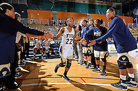 11 November 2011:  FIU's Jerica Coley (22) is welcomed to the court prior to the game.  The FIU Golden Panthers defeated the Jacksonville University Dolphins, 63-37, at the U.S. Century Bank Arena in Miami, Florida.