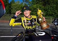May 6, 2018; Commerce, GA, USA; NHRA top fuel driver Leah Pritchett celebrates while wearing a Bitcoin hat after winning the Southern Nationals at Atlanta Dragway. Mandatory Credit: Mark J. Rebilas-USA TODAY Sports