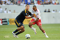 Omar Gonzalez (4) of the Los Angeles Galaxy fouls Thierry Henry (14) of the New York Red Bulls during a Major League Soccer (MLS) match at Red Bull Arena in Harrison, NJ, on August 14, 2010.