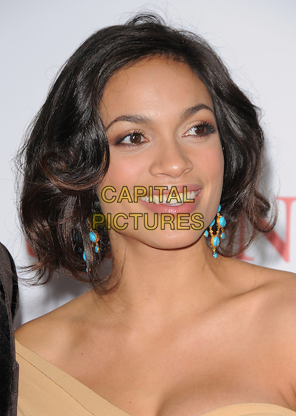 "ROSARIO DAWSON.L.A. Premiere of ""Seven Pounds"" held at The Mann Village Theatre in Westwood, California, USA. .December 16th, 2008.headshot portrait yellow cream orange off the shoulder one dangling turquoise earrings .CAP/DVS.©Debbie VanStory/Capital Pictures."