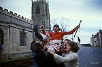 Haxey Hood Game. Haxey Lincolnshire 1970s. Catching the Fool and taking him to the mounting block where he wil be 'smoked'. Peter Bee as The Fool.