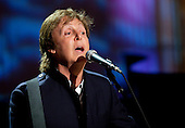 """Former Beatle Paul McCartney performs """"Michelle"""" in the East Room of the White House in Washington, D.C., U.S., on Wednesday, June 2, 2010. United States President Barack Obama presented McCartney with the Gershwin Prize for Popular Song awarded by the Library of Congress. .Credit: Andrew Harrer / Pool via CNP"""