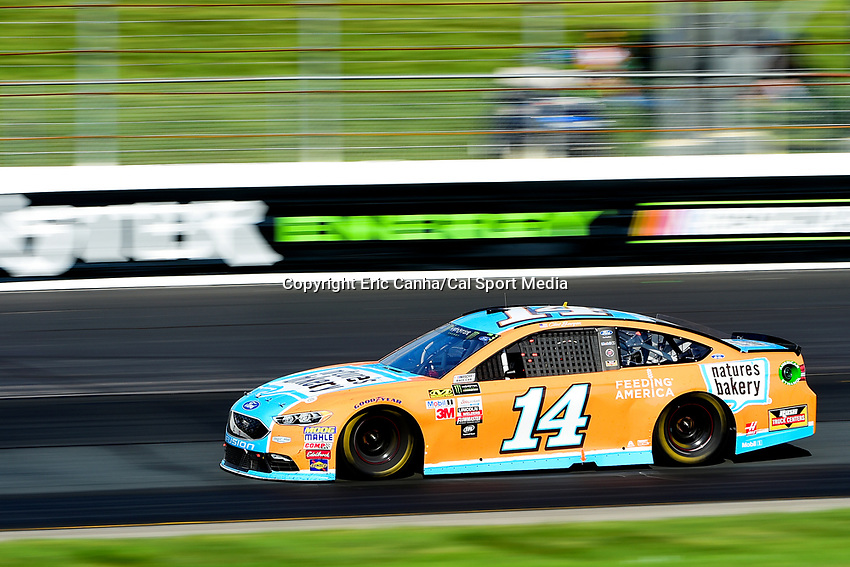 July 16, 2017 - Loudon, New Hampshire, U.S. - Clint Bowyer, Monster Energy NASCAR Cup Series driver of the Nature's Bakery / Feeding America Ford (14), races at the NASCAR Monster Energy Overton's 301 race held at the New Hampshire Motor Speedway in Loudon, New Hampshire. Eric Canha/CSM