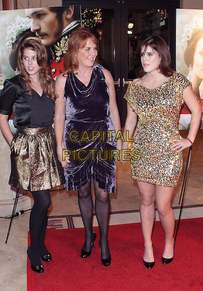 """PRINCESS BEATRICE, SARAH FERGUSON, Duchess of York & PRINCESS EUGENIE .""""The Young Victoria"""" US Premiere held The Pacific Theatres The Grove, Los Angeles, California, USA, .3rd December 2009..royal fergie family mother daughters sisters full length purple velvet dress black tights shoes gold sequined sequin skirt black top patent layered tiered holding hands .CAP/ADM/TC.©T. Conrad/AdMedia/Capital Pictures."""