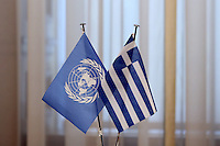 Pictured: The UN and Greek flags at Megaro Maximou in Athens, Greece. Saturday 18 June 2016<br /> Re: The United Nations secretary-general is visiting Greece, ahead of talks with government officials and a trip to the island of Lesbos, which is at the forefront of Greece's immigration crisis.<br /> Ban Ki-moon met with officials and volunteers at the Solidarity Now group, which helps victims of Greece's financial crisis and migrants stuck in the country.<br /> He has also visited Greek President Procopis Pavlopoulos before travelling camps on Lesbos island where 3,400 refugees and other migrants live.