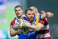 Picture by Allan McKenzie/SWpix.com - 13/04/2018 - Rugby League - Betfred Super League - Leeds Rhinos v Wigan Warriors - Headingley Carnegie Stadium, Leeds, England - Leeds's Adam Cuthbertson is tackled by Wigan's Tony Clubb & Liam Farrell.