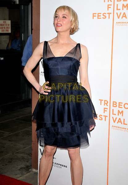 "RENEE ZELLWEGER.9th Annual Tribeca Film Festival ""My Own Love Song"" Premiere  held at Tribeca Performing Arts Center, New York, NY, USA..April 22nd, 2010.half length black dress 3/4 tulle sheer see thru through straps tiered ruffles fringe short hair cut layered hand on hip.CAP/ADM/BM.©Bill Menzel/AdMedia/Capital Pictures."