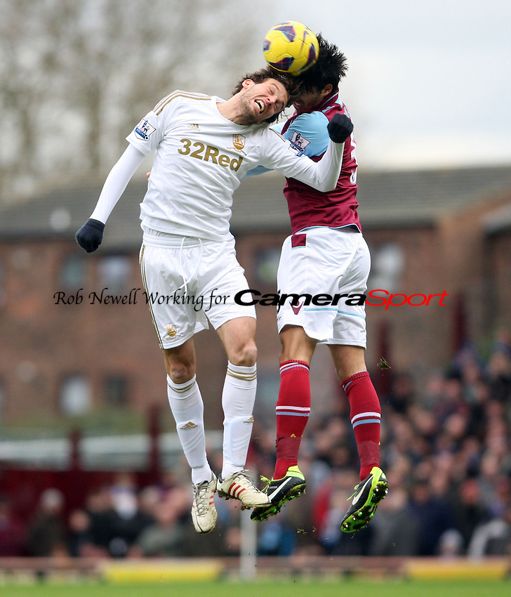 Michu of Swansea and James Tomkins of West Ham - West Ham United vs Swansea City, Barclays Premier League at Upton Park, West Ham - 02/02/13 - MANDATORY CREDIT: Rob Newell/TGSPHOTO - Self billing applies where appropriate - 0845 094 6026 - contact@tgsphoto.co.uk - NO UNPAID USE.