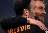 Calcio, ottavi di finale di Coppa Italia Tim: Roma vs Sampdoria. Roma, stadio Olimpico, 9 gennaio 2014.<br /> AS Roma defender Vasilis Torosidis, of Greece, celebrates with teammate Daniele De Rossi, right, after scoring during the Italy Cup round of sixteen football match between AS Roma and Sampdoria at Rome's Olympic stadium, 9 January 2014.<br /> UPDATE IMAGES PRESS/Isabella Bonotto