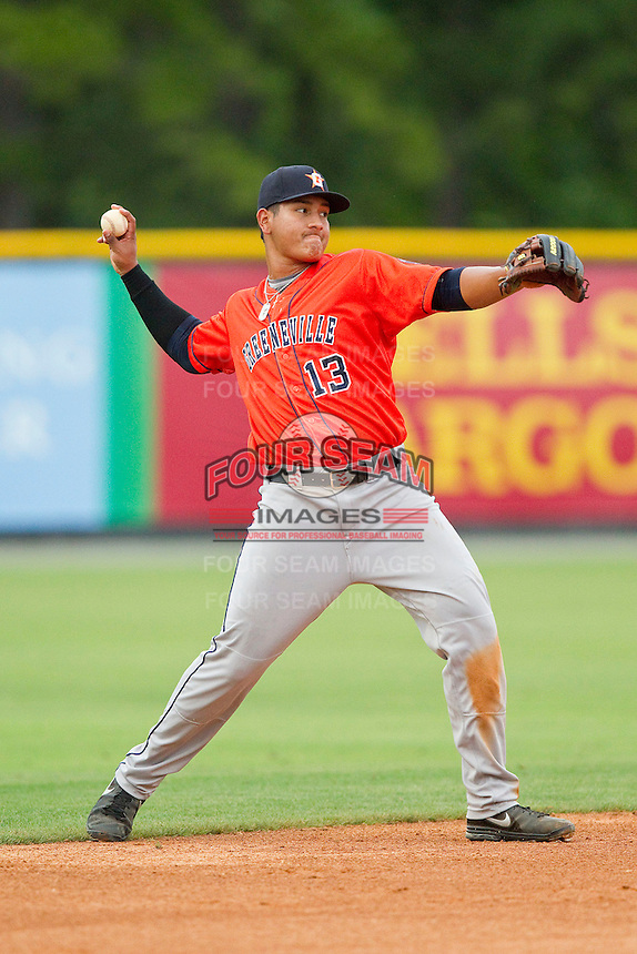 Greeneville Astros third baseman Angel Ibanez (13) makes a throw to first base against the Burlington Royals at Burlington Athletic Park on July 1, 2013 in Burlington, North Carolina.  The Astros defeated the Royals 8-1 in Game Two of a doubleheader.  (Brian Westerholt/Four Seam Images)
