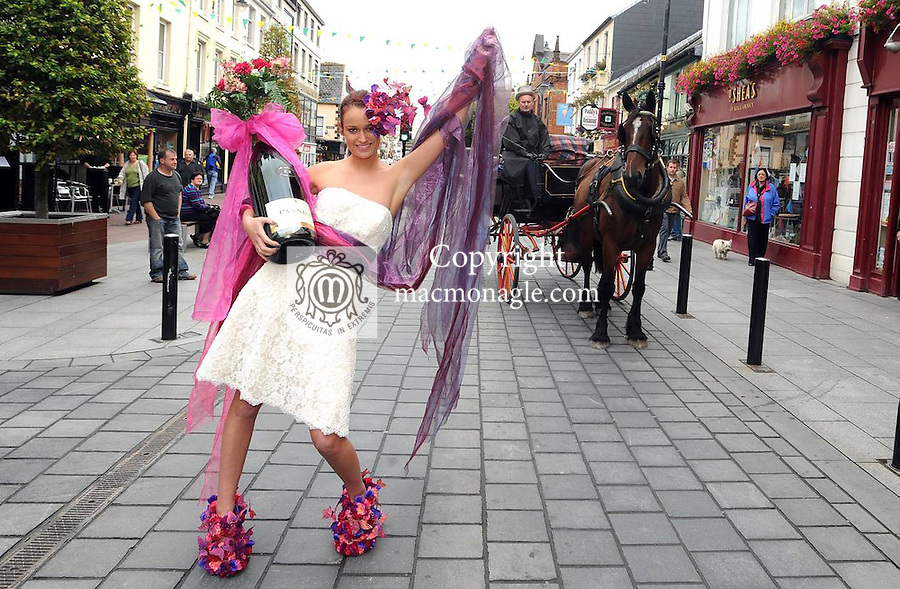 05-09-11: Mags Kelleher celebrates in Killarney, Co. Kerry,  on Monday after it was announced that the top award for the tidiest town in Ireland has gone to Killarney. In background is local jarvey Mike Sweetman and his horse 'Mr Browne'. Picture: Eamonn Keogh (MacMonagle, Killarney)