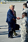 WEST PALM BEACH, FL - FEBRUARY 17: U.S. President Donald J. Trump shake hand with a couple of military soldier as he arrives on Air Force One at the Palm Beach International airport as they prepare to spend part of the weekend at Mar-a-Lago resort on February 17, 2017 in West Palm Beach, Florida. After touring and meeting with Dennis Muilenburg Chairman of the Board, President, and CEO of the Boeing Company in North Charleston, South Carolina.  President Trump schedule to hold a campaign rally tomorrow at Melbourne Florida. ( Photo by Johnny Louis / jlnphotography.com )