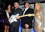HOLLYWOOD, FL - DECEMBER 09: Karina Brez, Miss Florida USA 2012, Barry Gibb of The Bee Gees, Phil Madow president of the Seminole Hard Rock Hotel & Casino and Gracie Simmons, Miss Florida Teen USA 2012  attends the Seminole Hard Rock Winterfest Boat Parade 2011 Grand Marshal reception at Passion Night Club! in the Seminole Hard Rock Hotel & Casino on December 9, 2011 in Hollywood, Florida. (Photo by Johnny Louis/jlnphotography.com)