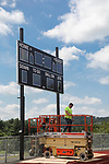 WATERTOWN, CT, 31 August, 2017 - 083117LW07 - Workers install a new wireless scoreboard at Watertown High School Thursday. The first football game of the season is Sept. 8.<br /> Laraine Weschler Republican-American
