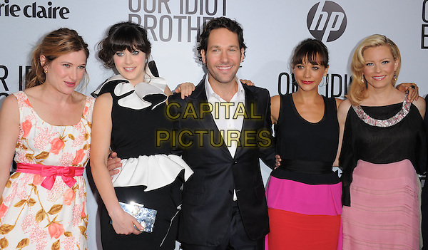 "Kathryn Hahn, Zooey Deschanel, Paul Rudd, Rashida Jones & Elizabeth Banks.""Our Idiot Brother"" Los Angeles Premiere held at Arclight Cinemas, Hollywood, California, USA..August 16th, 2011.half length white pink floral print dress suit jacket shirt red ruffle sleeveless ribbon waist clutch bag                     .CAP/RKE/DVS.©DVS/RockinExposures/Capital Pictures."