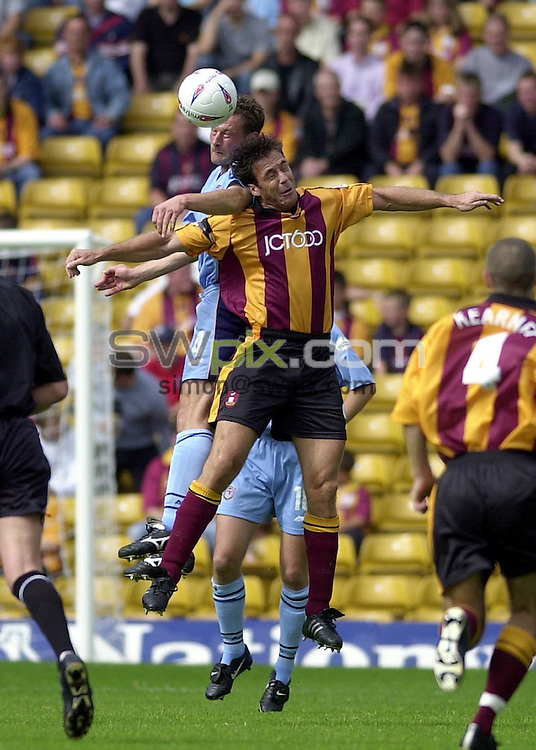 Pix: Matthew Lewis/SWpix.com. Soccer. Nationwide Division One. Bradford City v Grimsby. 24/08/2002...COPYWRIGHT PICTURE>>SIMON WILKINSON>>01943 436649>>..Bradford's Ashley Ward and Grimsby's Paul Groves challenge for the ball.