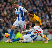 Wolverhampton Wanderers' Joao Moutinho (centre) under pressure from Bournemouth's Andrew Surman (left)  &amp; Solly March (right) <br /> <br /> Photographer David Horton/CameraSport<br /> <br /> The Premier League - Brighton and Hove Albion v Wolverhampton Wanderers - Saturday 27th October 2018 - The Amex Stadium - Brighton<br /> <br /> World Copyright &copy; 2018 CameraSport. All rights reserved. 43 Linden Ave. Countesthorpe. Leicester. England. LE8 5PG - Tel: +44 (0) 116 277 4147 - admin@camerasport.com - www.camerasport.com