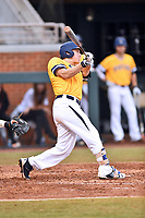 University of North Carolina Greensboro (UNCG) Spartans center fielder Andrew Moritz (4) swings at a pitch during a game against the Tennessee Volunteers at Lindsey Nelson Stadium on February 24, 2018 in Knoxville, Tennessee. The Volunteers defeated Spartans 11-4. (Tony Farlow/Four Seam Images)